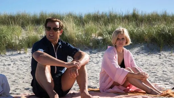 """This image released by Entertainment Studios shows Jason Clarke as Ted Kennedy, left, and Kate Mara as Mary Jo Kopechne in a scene from """"Chappaquiddick."""" (Claire Folger/Entertainment Studios via AP)"""