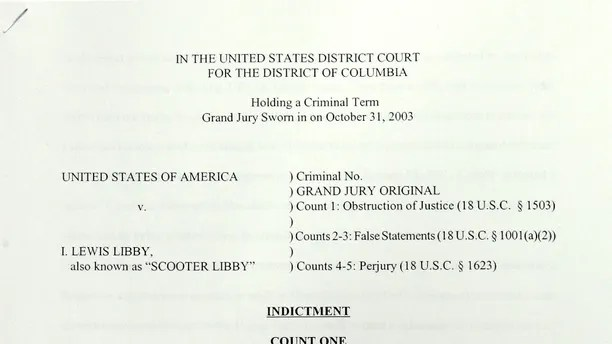 The criminal indictment document prepared by Special Counsel Patrick Fitzgerald charging U.S. Vice President Dick Cheney's chief of staff Lewis 'Scooter' Libby is shown after being released at the Justice Department in Washington October 28, 2005. Libby, who immediately resigned his position at the White House, was indicted on five criminal counts of obstruction of justice, perjury and making false statements after a two-year investigation into the leak of a covert CIA operative Valerie Plame's identity. REUTERS/Jim Bourg - RP2DSFHDHTAF