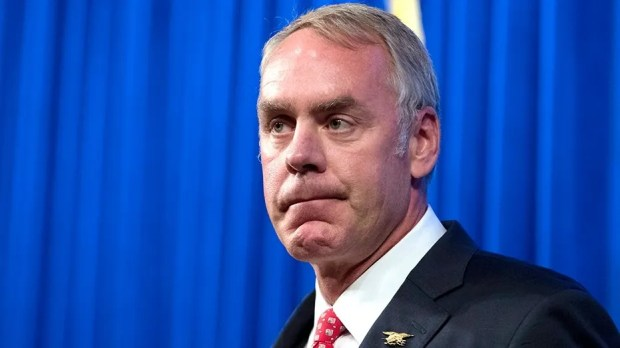 The Interior Department inspector general's office found that two charter flights Ryan Zinke took last year 'appeared reasonable and related to DOI business'