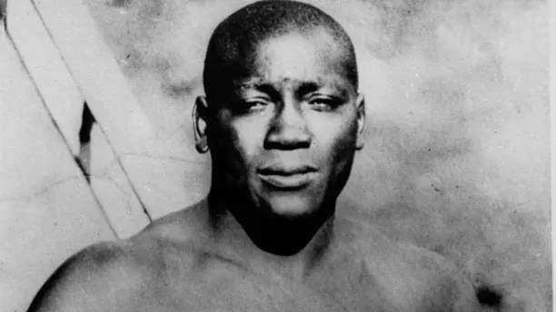 """FILE - This undated photo shows boxer Jack Johnson.  President Donald Trump says he's considering """"a Full Pardon!"""" for boxing's first black heavyweight champion more than 100 years after Jack Johnson was convicted by all-white jury of """"immorality"""" for one of his relationships. Trump tweets that the actor Sylvester Stallone called him to share Johnson's story. Trump says Johnson's """"trials and tribulations were great, his life complex and controversial.""""  The president adds: """"Others have looked at this over the years, most thought it would be done, but yes, I am considering a Full Pardon!""""  (AP Photo/File"""