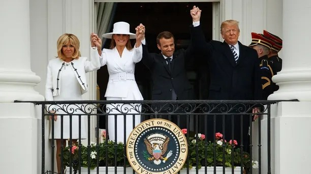 Brigitte Macron, first lady Melania Trump, French President Emmanuel Macron, and President Donald Trump join hands during a State Arrival Ceremony on the South Lawn of the White House, Tuesday, April 24, 2018, in Washington. (AP Photo/Evan Vucci)