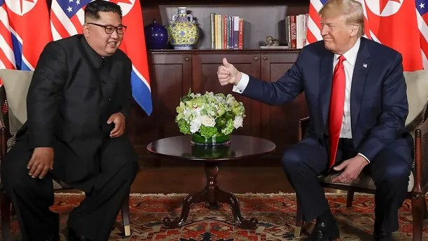 U. S. Donald Trump gives North Korea leader Kim Jong Un a thumbs up at their meeting at the Capella resort on Sentosa Island Tuesday, June 12, 2018 in Singapore. (AP Photo/Evan Vucci)