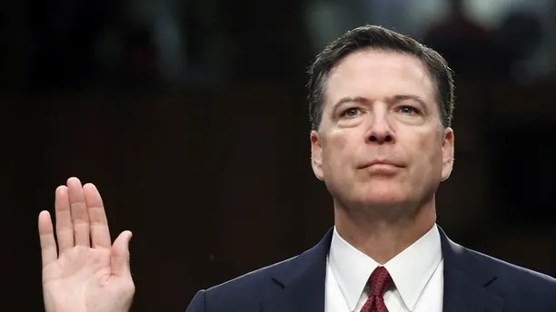 """FILe - In this June 8, 2017 file photo, former FBI Director James Comey is sworn in during a Senate Intelligence Committee hearing on Capitol Hill in Washington. Comey's publisher is moving up the release date of his memoir """"A Higher Loyalty,"""" to April 17. (AP Photo/Alex Brandon, File)"""