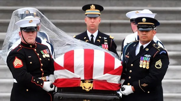 The casket of Sen. John McCain, R-Ariz., is carried down the steps of the U.S. Capitol in Washington, Saturday, Sept. 1, 2018, in Washington, for a departure to the Washington National Cathedral for a memorial service. (Marvin Joseph/The Washington Post via AP, Pool)