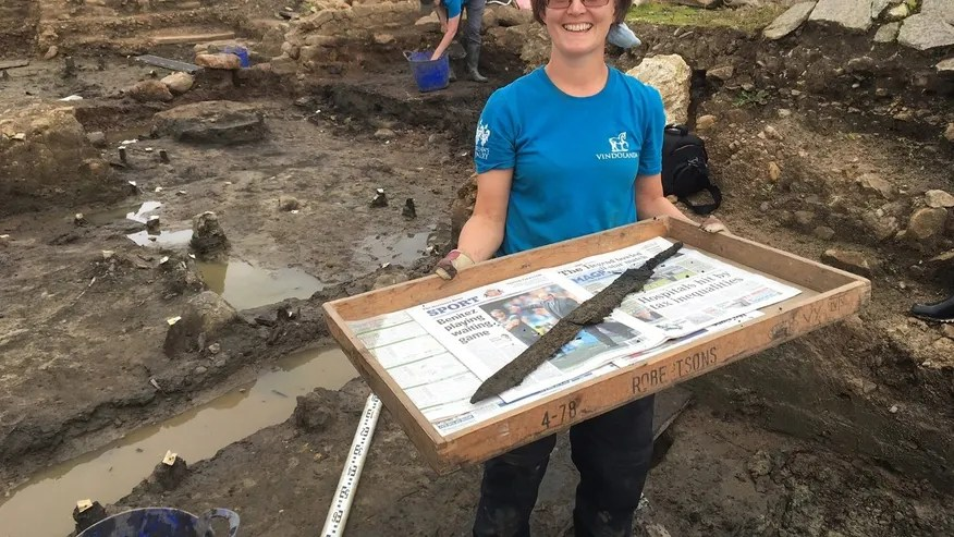 Volunteer Sarah Baker who discovered the second sword at Vindolanda (The Vindolanda Trust).