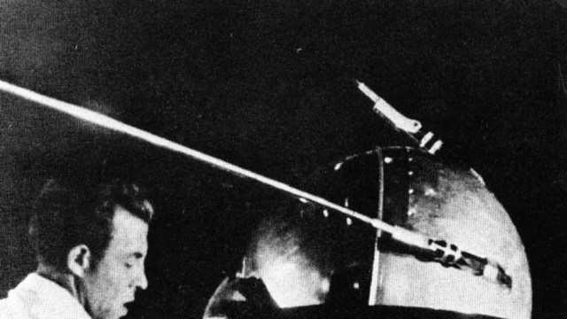 A Soviet technician works on Sputnik 1 before the satellite's Oct. 4, 1957, launch.