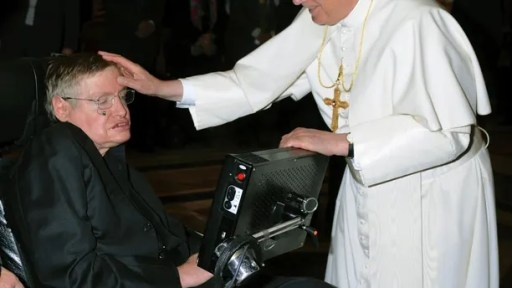 Pope Benedict XVI (R) greets British professor Stephen Hawking during a meeting of science academics at the Vatican October 31, 2008.   REUTERS/Osservatore Romano (VATICAN) - GM1E4B104EF01