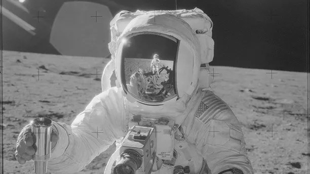 Astronaut Alan L. Bean holds a Special Environmental Sample Container filled with lunar soil collected during the Apollo 12 mission in this November 19, 1969 NASA handout photo. Mission commander Charles Conrad Jr., who took this picture, is reflected in Bean's helmet visor. The photograph is one of more than 12,000 from NASA's archives recently aggregated on the Project Apollo Archive Flickr account. REUTERS/NASA/Handout via Reuters THIS IMAGE HAS BEEN SUPPLIED BY A THIRD PARTY. IT IS DISTRIBUTED, EXACTLY AS RECEIVED BY REUTERS, AS A SERVICE TO CLIENTS. FOR EDITORIAL USE ONLY. NOT FOR SALE FOR MARKETING OR ADVERTISING CAMPAIGNS - TM3EBA90YYJ01