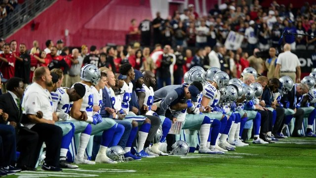 Dallas Cowboys players, coaches and staff took a knee prior to the national anthem Monday.