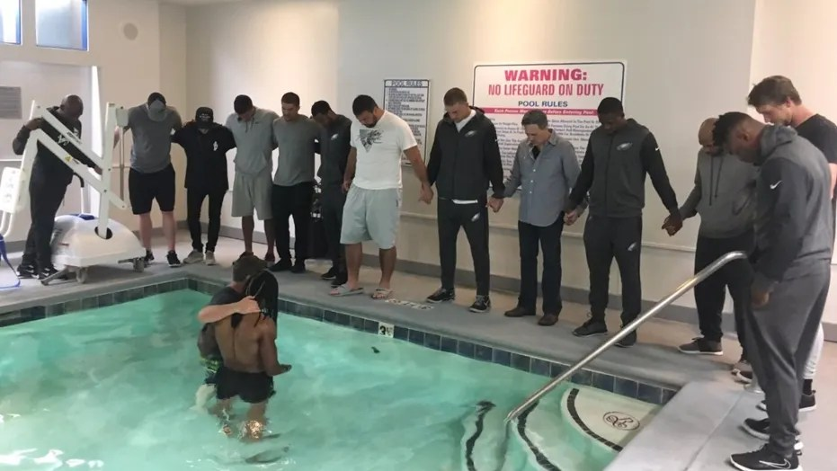 Philadelphia Eagles' wide receiver Marcus Johnson was baptized Thursday with support from several of his teammates.
