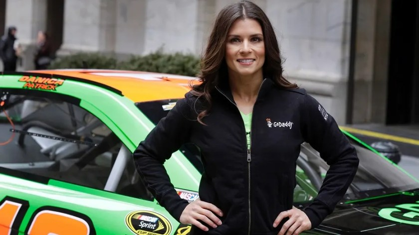 In this April 1, 2015, file photo, face car driver Danica Patrick poses with her car in front of the New York Stock Exchange before the GoDaddy IPO.