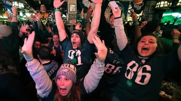Fans react to an Eagles touchdown during Super Bowl 52 between the Philadelphia Eagles and the New England Patriots, Sunday, Feb. 4, 2018, in Philadelphia. (AP Photo/Matt Rourke)