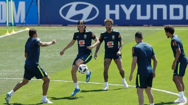 Brazil's soccer players Filipe Luis, center left, and Neymar practice with teammates during a training session in Sochi, Russia, Tuesday, June 12, 2018. Brazil will face Switzerland on June 17 in the group E for the soccer World Cup. (AP Photo/Andre Penner)