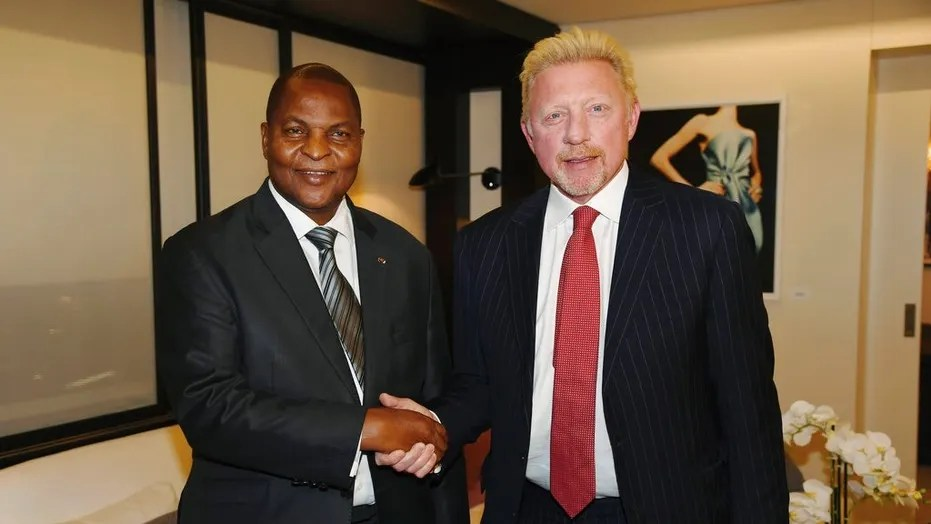 In this photo originally released on April 27, President Faustin Archange Touadera, left, shakes hands with retired tennis star Boris Becker, in Brussels, after it was announced he had been appointed by the CAR as a cultural attache