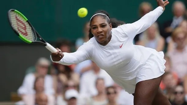 Serena Williams of the United States returns the ball to Germany's Angelique Kerber during their women's singles final match at the Wimbledon Tennis Championships, in London, Saturday July 14, 2018.(AP Photo/Tim Ireland)