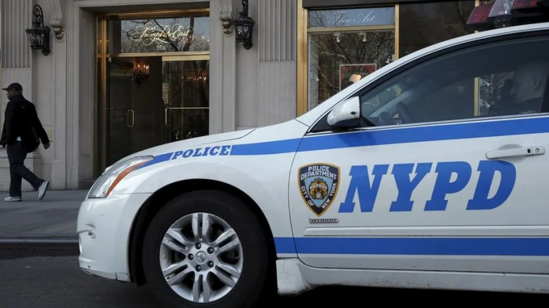 File photo - A New York City Police (NYPD) car is parked outside the entrance to Trump Parc East, a luxury apartment building in mid-Manhattan, in New York March 18, 2016. (REUTERS/Brendan McDermid)
