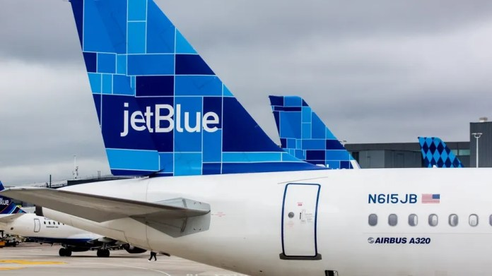A JetBlue flight return to Boston's Logan Airport on Saturday afternoon after customers and crew began feeling ill.