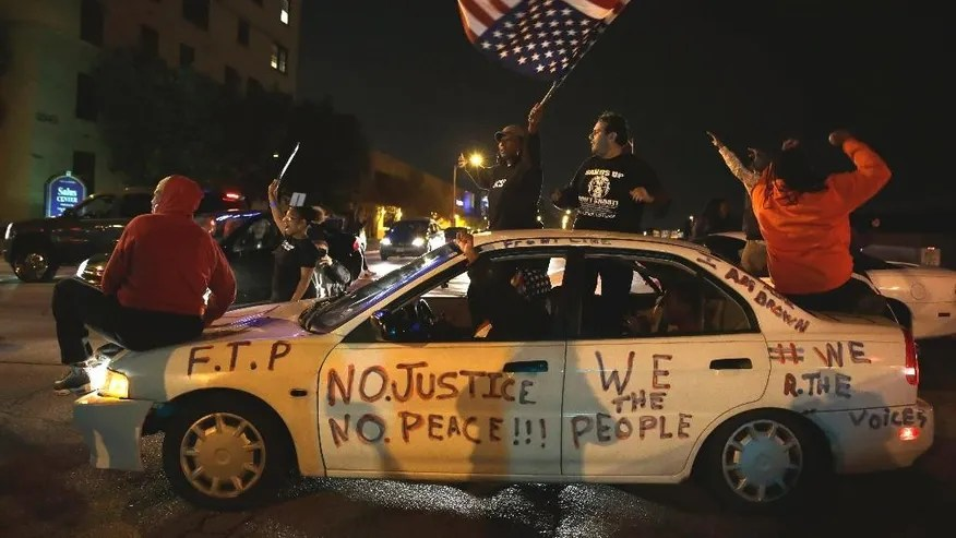 Protesters riled by police killing of black 18-year-old ...