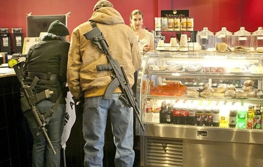 December 7, 2013: Stephanie McDonald and James Franklin buy coffee while participating in an open carry demonstration in Texas (AP).