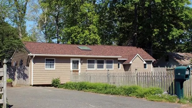 This May 18, 2017 photo shows one of 40 homes in a community run by the German American Settlement League in Yaphank, N.Y. The organization has settled a case with New York's attorney general, who claimed the GASL was not complying with state and federal fair housing laws because it had restricted ownership of homes to people of German descent. The agreement with the attorney general calls for the ouster of organization leaders and regular reports to the state indicating compliance with all laws. (AP Photo/Frank Eltman).