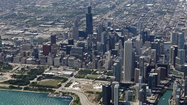 An aerial view shows the skyline and lakefront of Chicago, Illinois, August 14, 2014. REUTERS/Jim Young (UNITED STATES - Tags: CITYSCAPE SOCIETY) - RTR42H5O