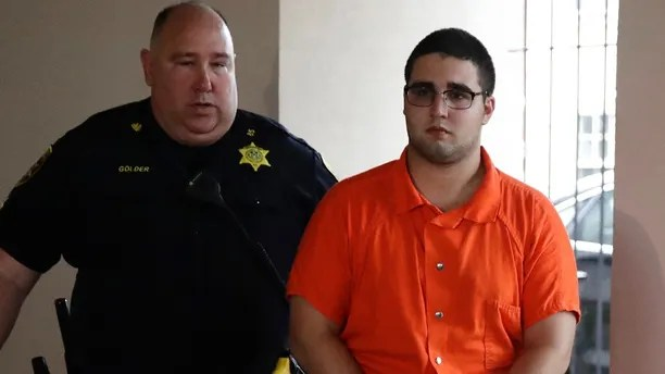 A law enforcement official escorts Cosmo DiNardo to a vehicle Thursday, July 13, 2017, in Doylestown, Pa. Lawyer Paul Lang, a defense attorney for DiNardo, said Thursday that his client has admitted killing the four men who went missing last week and told authorities the location of the bodies. Lang says prosecutors agreed to take the death penalty off the table in return for DiNardo's cooperation. (AP Photo/Matt Rourke)
