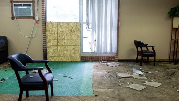 Debris is scattered around a room inside the Dar Al Farooq Islamic Center, in Bloomington, Minn., on Sunday, Aug. 6, 2017. An explosion damaged the room and shattered windows as worshippers prepared for morning prayers early Saturday. (Courtney Pedroza/Star Tribune via AP)