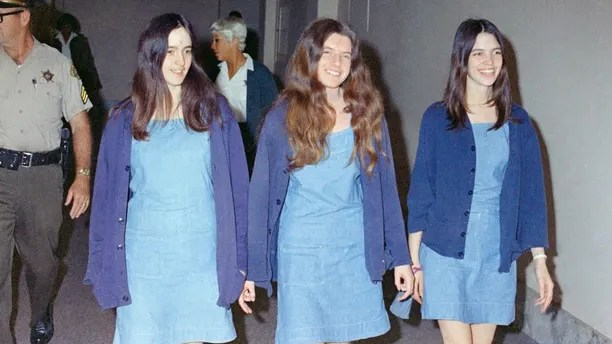 FILE - In this Aug. 20, 1970 file photo, Charles Manson followers, from left: Susan Atkins, Patricia Krenwinkel and Leslie Van Houten, walk to court to appear for their roles in the 1969 cult killings of seven people, including pregnant actress Sharon Tate, in Los Angeles, Calif. Van Houten is expected to get a court hearing Thursday, Aug. 31, 2017, to evaluate the role of her young age in the killing of a California couple four decades ago.(AP Photo/George Brich, File)