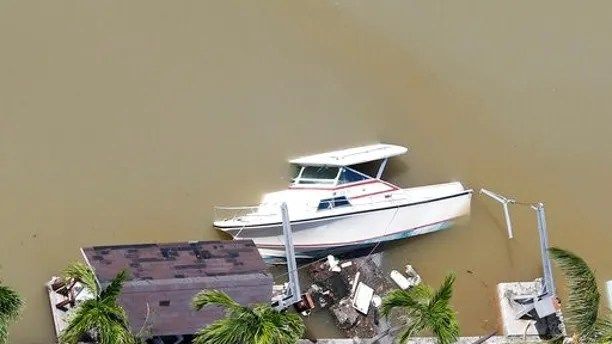 A boat is partially submerged in a canal in the wake of Hurricane Irma, Monday, Sept. 11, 2017, in Key Largo, Fla. (AP Photo/Wilfredo Lee)