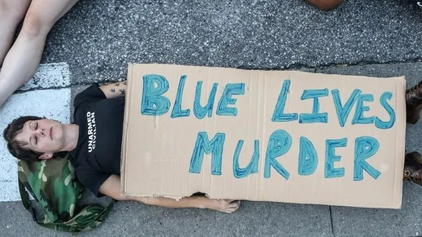 "A protester participates in a ""Die-In""  during a second day of demonstrations after a not guilty verdict in the murder trial of former St. Louis police officer Jason Stockley, charged with the 2011 shooting of  Anthony Lamar Smith, who was black, in St. Louis, Missouri, U.S., September 16, 2017.  Photo taken September 16, 2017.  REUTERS/Lawrence Bryant - RC1B82FFA4C0"
