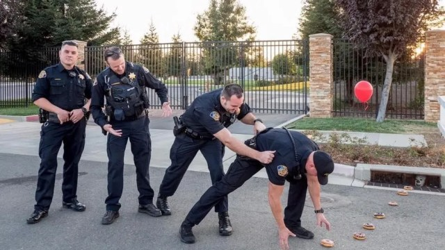 "The police officers posted a photo of their rendition of Stephen King's ""It."""