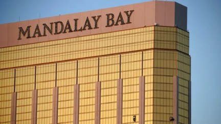 FILE - In this Monday, Oct. 2, 2017 file photo, drapes billow out of broken windows at the Mandalay Bay resort and casino on the Las Vegas Strip, following a deadly shooting at a music festival in Las Vegas. Police who have yet to find Stephen Paddock's motive for the massacre said Friday, that they will enlist the public's help. The FBI's Aaron Rouse says billboards will ask people with credible information to call the agency at 800-CALL-FBI. (AP Photo/John Locher, File)