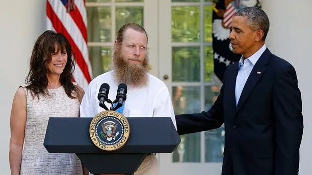 U.S. President Barack Obama (R) watches as Jami Bergdahl (L) and Bob Bergdahl talk about the release of their son, prisoner of war U.S. Army Sergeant Bowe Bergdahl, during a statement in the Rose Garden at the White House in Washington May 31, 2014. Obama, flanked by the parents of Army Sergeant Bowe Bergdahl, a U.S. soldier who is being released after being held for nearly five years by the Taliban, said in the White House Rose Garden on Saturday that the United States has an