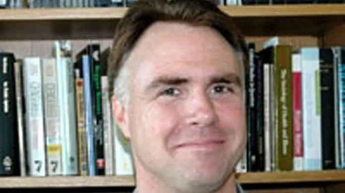 James Tracy, a fired tenured professor, appeared in court Thursday to argue his free speech rights were violated after the university fired him.