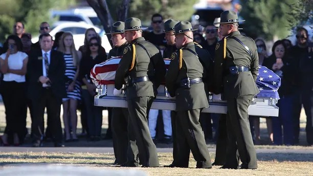 Border Patrol pallbearers carry Border Patrol agent Rogelio Martinez to a graveside service at Restlawn Cemetery, Saturday, Nov. 25, 2017 in El Paso, Texas. Martinez was on patrol in the Big Bend Sector when he died in the line of duty. (Mark Lambie/The El Paso Times via AP)