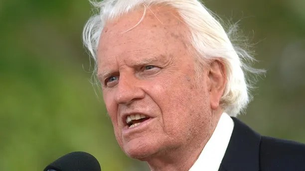 FILE - In this June 26, 2005 file photo, the Rev. Billy Graham speaks on stage on the third and last day of his farewell American revival in the Queens borough of New York.  A spokesman said on Graham has died at his home in North Carolina at age 99. (AP Photo/Henny Ray Abrams)