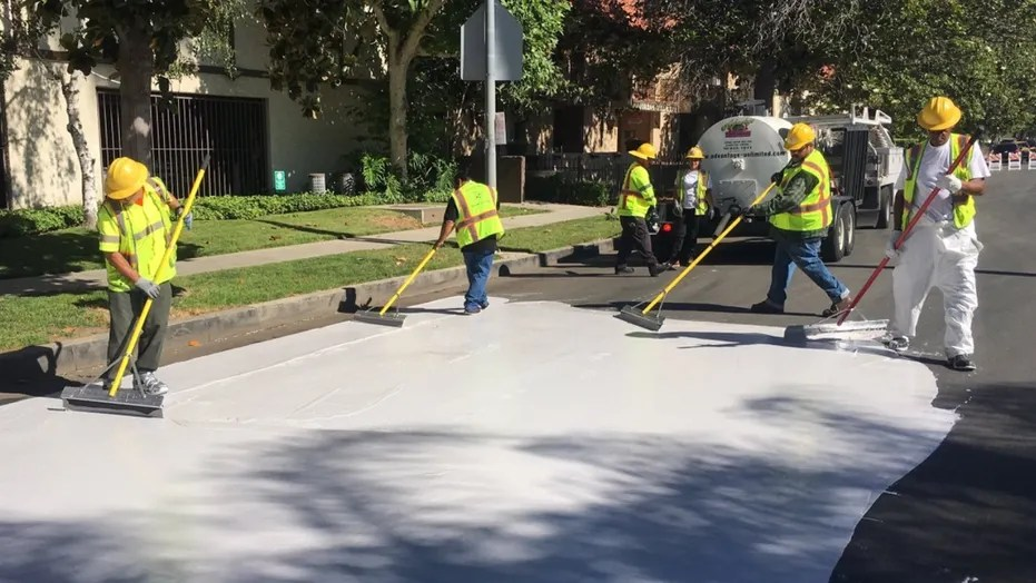 """Officials in Los Angeles are painting streets white to reduce the effect of urban """"heat islands."""""""