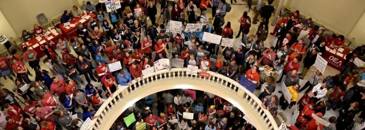 Teachers pack the state Capitol rotunda to capacity, on the second day of a teacher walkout, to demand higher pay and more funding for education, in Oklahoma City, Oklahoma, U.S., April 3, 2018.  REUTERS/Nick Oxford TPX IMAGES OF THE DAY - RC1482AB0B40