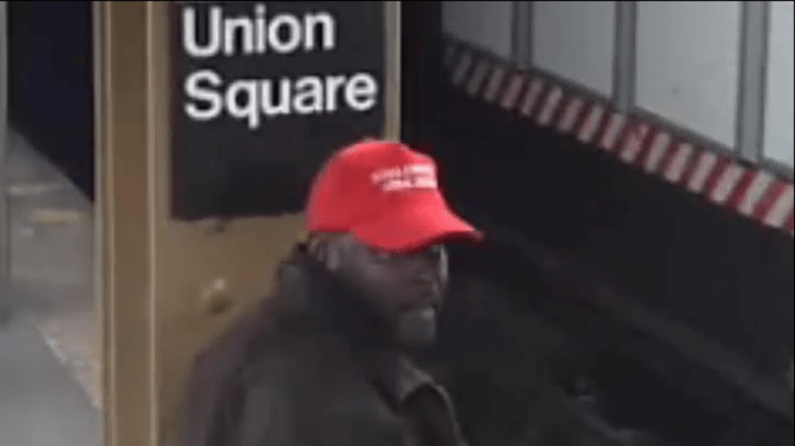 """Police say a man wearing """"Make America Great Again"""" apparel attacked a commuter on Friday."""