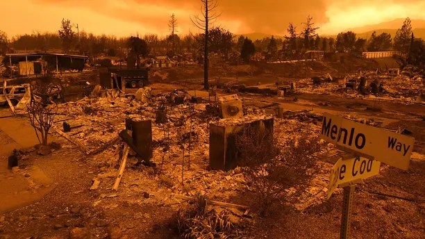 CORRECTS DATE TO JULY 27 - Homes leveled by the Carr Fire line the Lake Keswick Estates area of Redding, Calif., on Friday, July 27, 2018. (AP Photo/Noah Berger)