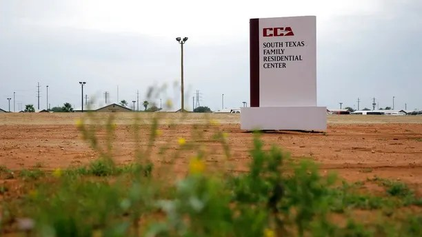 FILE - This June 30, 2015 file photo shows a sign at the entrance to the South Texas Family Residential Center in Dilley, Texas. A report that a child died shortly after being released from a U.S. Immigration and Customs Enforcement facility in Texas has inflamed the debate over the detention of immigrant families. The American Immigration Lawyers Association said Wednesday, Aug. 1, 2018, that it had learned of the death of a child shortly after the child and parent left the ICE family detention center at Dilley. (AP Photo/Eric Gay, File)