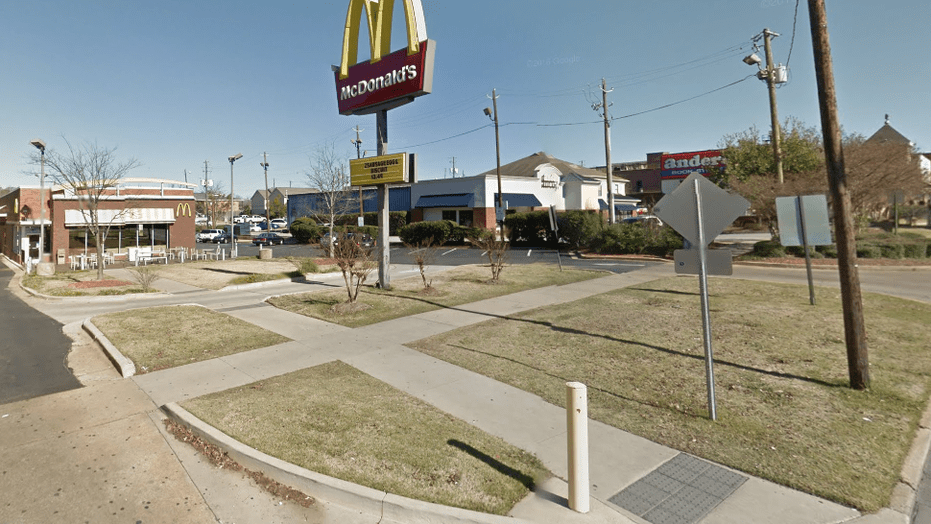 A man was killed and four others were wounded after shots were fired at a McDonald's near Auburn University, police said.