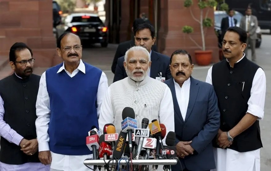 India's Prime Minister Narendra Modi (C) speaks with the media inside the parliament premises upon his arrival on the first day of the budget session in New Delhi, India, February 23, 2016. REUTERS/Adnan Abidi - RTX284LF