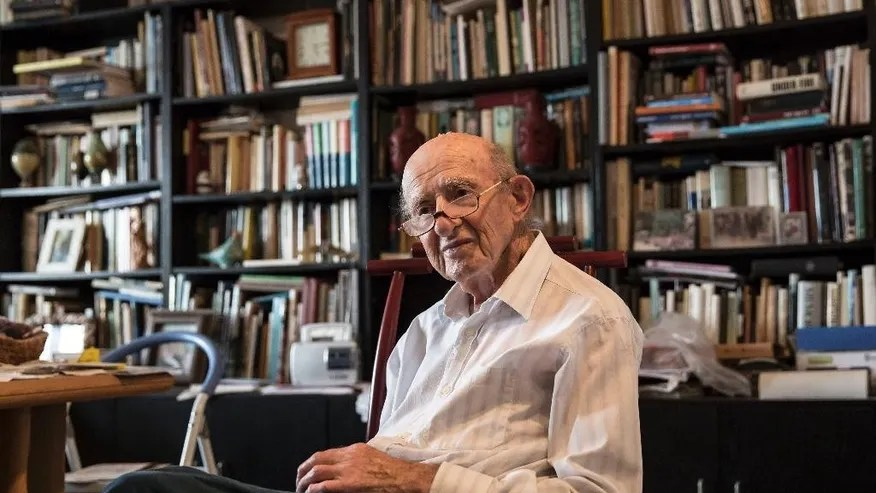 """In this photo made on Monday, May 23, 2016, Joseph Harmatz sits during an interview with the Associated Press at his apartment in Tel Aviv, Israel. Harmatz is one of the few remaining Jewish """"Avengers"""" who carried out a mass poisoning of former SS men in an American prisoner-of-war camp in 1946 after World War II. The poisoning sickened more than 2,200 Germans but ultimately caused no known deaths.(AP Photo /Tsafrir Abayov)"""