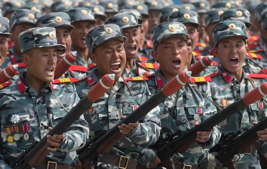 3074194 04/15/2017 Soldiers during a military parade marking the 105th birthday of Kim Il-Sung, the founder of North Korea, in Pyongyang. Iliya Pitalev/Sputnik  via AP