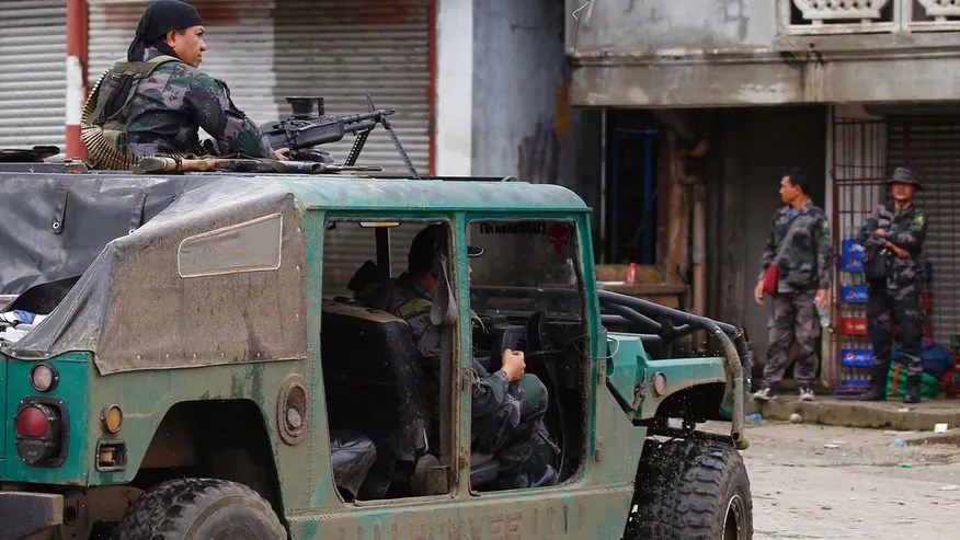 Police patrol the streets of Marawi city as government troops battle with Muslim militants who continue to hold their ground in some areas of the city for almost a week Monday in the southern Philippines.