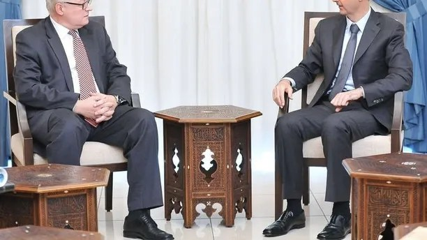 A handout picture released by the official Syrian Arab News Agency (SANA) on September 18, 2013 shows Russian Deputy Foreign Minister Sergei Ryabkov (left) meeting with Syrian President Bashar al-Assad in Damascus.
