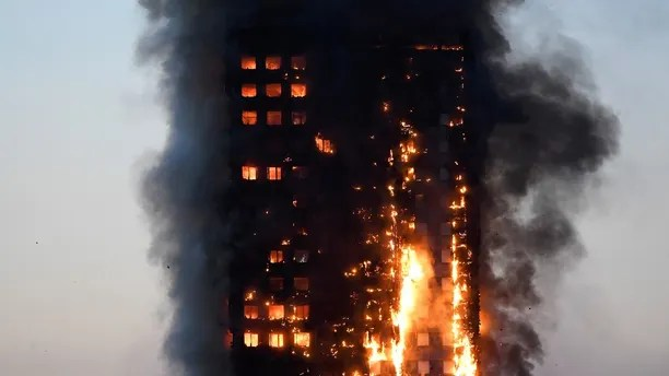 Flames and smoke billow as firefighters deal with a serious fire in a tower block at Latimer Road in West London, Britain June 14, 2017. REUTERS/Toby Melville - RTS16YX2