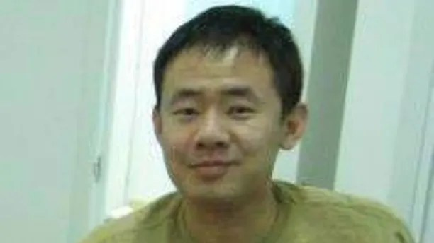 "This 2009 handout photo released by a friend of Xiyue Wang, shows Xiyue Wang at his apartment in Hong Kong, China. Princeton University professor Stephen Kotkin, who advised Wang, a Chinese-American researcher sentenced to prison in Iran, defended his former student as innocent of all charges against him. Kotkin told The Associated Press by email that Xiyue Wang is a ""remarkable, linguistically gifted graduate student"" who studied governance in 19th and early 20th century Muslim regions. (Friend of Xiyue Wang via AP)"