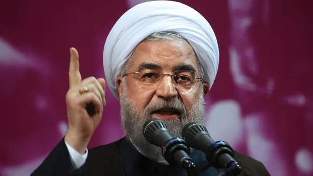 FILE - In this Tuesday, May 9, 2017 file photo, Iranian President Hassan Rouhani speaks in a campaign rally for May 19 presidential election in Tehran, Iran. Iranians head to the polls Friday to vote in the Islamic Republic's presidential election, casting ballots in a contest largely seen as a referendum on the country's nuclear deal with world powers. Rouhani, 68, is a moderate cleric elected in 2013 on pledges of greater personal freedoms and improved relations with the West. His government negotiated the 2015 nuclear deal, which saw Iran accept curbs on its nuclear program in exchange for relief from crippling international sanctions. (AP Photo/Vahid Salemi, File)